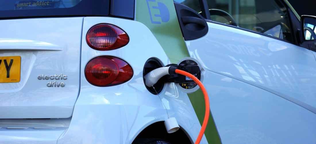 white and orange gasoline nozzle