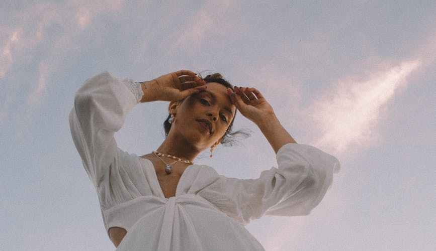 low angle photo of woman wearing white dress